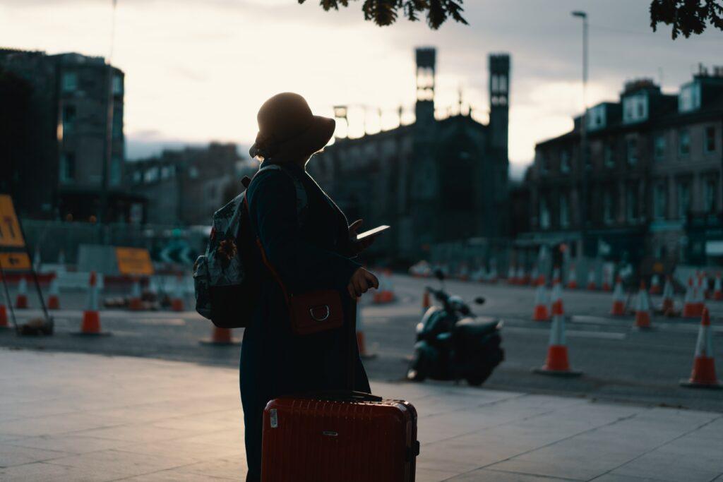 Solo traveler using travel apps to navigate Edinburgh
